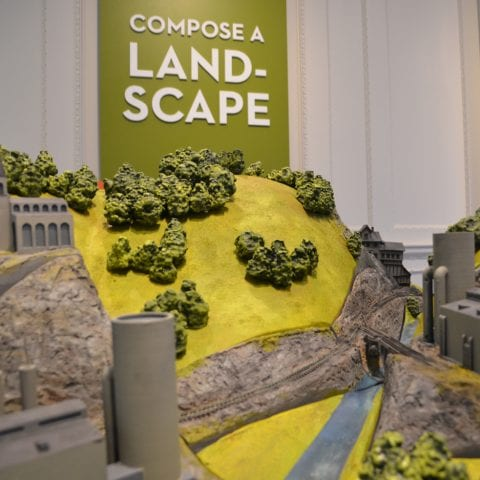compose a land-scape museum display